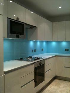 I love the glass as a reflective surface- Blue kitchen splashback