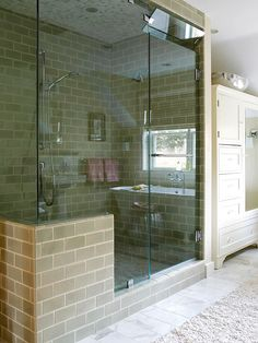 "Shower and Steam Room A floor-to-ceiling shower enclosure and a hidden steam generator add ""steam room"" to the list of this shower's amenities. A transom window helps circulate air when just the shower is being used. Dual showerheads and green subway tile Lake Bathroom, Small Bathroom With Shower, Modern Bathroom, Master Bathroom, Bathroom Showers, Big Shower, Master Shower, Modern Shower, Double Shower"