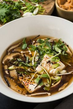 Mushroom Miso Soup - NYT Cooking: This miso-enriched brothy soup is pleasing on many levels. You get complex flavor with minimal effort, especially if you make the dashi in advance. All the little garnishes are optional. Soup Recipes, Vegetarian Recipes, Cooking Recipes, Healthy Recipes, Nytimes Recipes, Healthy Soup, Asian Recipes, Ethnic Recipes, Asian Foods
