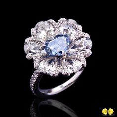Stunning blue Diamond surrounded by beautiful pear shaped white Diamond petals. Novel Collection Asia( A treasure to admire and pass on as an heirloom to next generation, fancy vivid blue diamond the… 」 Emerald Ring Vintage, Vintage Diamond, Diamond Gemstone, Diamond Jewelry, Diamond Rings, Heart Jewelry, Fine Jewelry, Jewellery, Heart Shaped Diamond Ring