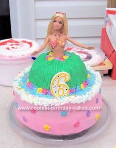 Homemade Hula Girl Birthday Cake: For the base of the Hula Girl Birthday Cake I used a 10 round cake pan. I doubled the layers of cake on the base, with butter cream icing to separate the