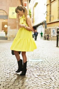 yellow dress with black cowboy boots