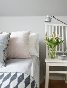 Use a simple chair as a night stand Simplicity-blog-pastel-bed-room-Scandinavian-style-pillows