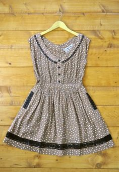 A vintage throw back, this light brown dress is dotted with white. Trimmed with black detailing at the neck, and lace along the side pockets and hem. Buttons are playfully poised down the front for show and lead to a skirt that is lined. Pair with flats for sweetness or cowboy boots to be the belle of the party. $64