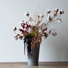 """Tall cotton stems and velvety amaranth add texture and structural appeal to this everlasting arrangement.Dried Cotton Stem- Cotton branch, wire- Imported32""""LHanging Black AmaranthBunch- Indoor use only- Imported5.5""""W, 32""""LBurnt Oak Phalaris Bunch- Indoor use only- Imported25""""H, 6"""" diameterDried Sea Oat Grass- Indoor use- USA34""""H"""