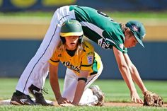 Chula VIsta, Calif.'s Micah Pietila-Wiggs, bottom, breaks up a double play as Westport, Conn., second baseman Max Popken falls over him during the first inning inning of the United States Championship game at the Little League World Series tournament in South Williamsport, Pa., Saturday, Aug. 24, 2013. (Matt Slocum/AP)