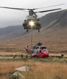 "A RAF Chinook helping lift a ""sick"" Royal Navy Sea King. Military Helicopter, Military Aircraft, Igor Sikorsky, Augusta Westland, Coast Guard Rescue, Air Machine, British Armed Forces, Royal Air Force, Royal Navy"