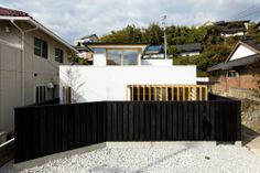 Shiiki Building is a minimalist house located in Yamaguchi, Japan, designed by Atelier Tekuto. The project is a two-family home in the small town of Shimonoseki.