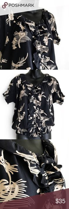 """J o i e • S i l k • B l o u s e • Sz XS Joie Black/Cream Floral Crew Neck, Ruffle Button Down and Short Sleeve Blouse, Size XS.  100% Silk w/ elastic sleeves and a banded bottom. This Blouse is in Excellent Used Condition - no holes, rips, tears or stains.  Length-24"""" Chest-20"""" Sleeve 9"""" Dry clean only Joie Tops Blouses"""