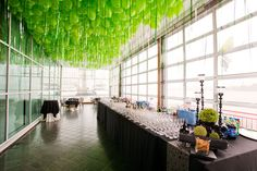 Hundreds of green balloons hung overhead in the cocktail area, the attached strings designed to look like blades of grass. Photo: Roger Dong for BizBash
