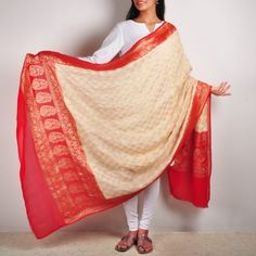 This subtle beige & red handwoven Banarasi silk & zari dupatta is accentuated with traditional Indian floral motifs in shining gold. It has unfinished edges which gives it a raw look.  www.tadpolestore.com  #duppata #designer #ethnic #shopping #designers #online #design #fashion #clothing #women #Indian #TadpoleStore
