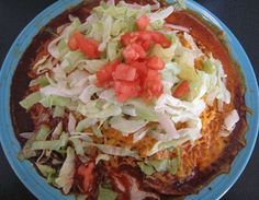 """. .    This is another New Mexican favorite, almost always served flat. Different than the rolled up Mexican version.    Also, a million times better tasting!  I guess I'm a little biased when it comes to that, but hey, """"I sure do love my New Mexican Style enchiladas"""". Ingredients   1"""