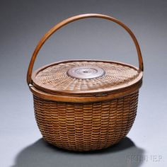 Deep Round Swing-handled Covered Nantucket Basket, late 19th/early 20th century, medium deep round basket with hinged cover, carved oak swing handle, shellacked, (imperfections), ht. to rim 6 3/4,