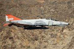 https://flic.kr/p/NEMwvy | Elvis Has left the Canyon | Ron King aka Elvis leads Wam and their 2 QF-4E Phantom Target drones through the Jedi Transition in California for one last time as the aircraft transited from Pt Mugu to Hill AFB in Utah. A quite amazing day personally as I never thought I would ever have the opportunity to photograph any F-4 Phantoms at low level anywhere never mind 2 of the last handful of QF-4`s from the 82nd ATRS.The aircraft will Phinally stop flying towards the…