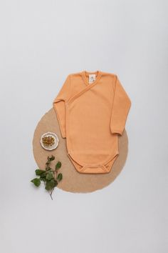 NEW in our beloved Baby Essentials - ongoing Collection . NEW - Fabric - 100% organic cotton, GOTS Ribbed-Jersey in a VINTAGE-LOOK Soft - Stretchy - Breathable! Made with Love in EU. .  Wrap-body The ribbed Jersey fabric in skin friendly organic quality allows it to stretch while always maintaining its shape and color.  #babybasics #organicbyfeldman #ochre #ocker #newbornessentials #ribbedjersey #madeineu #babymode #organicbabyclothes #biobaumwolle Newborn Essentials, Body Wraps, Organic Baby Clothes, Baby Body, Vintage Looks, Saddle Bags, Organic Cotton, Long Sleeve, Fabric