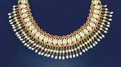 Indian necklace composed of a series of foiled pear shaped colourless gems with foiled ruby and green foiled gem detail, suspending a foiled colourless gem, cultured pearl and green paste fringe, to a cord fastener