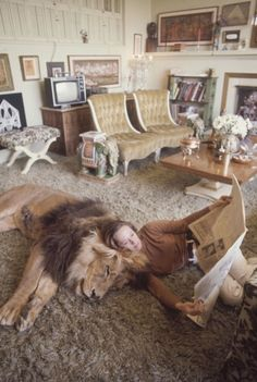 Actress Tippi Hedren and family at home with their 400-pound pet lion, Neil (1971) - Imgur
