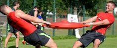 Rhys Priestland and Hallam Amos tussle in training