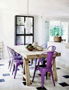 These eye-catching purple chairs liven up this neutral kitchen space