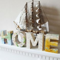 Cover paper mache alphas with maps of your home town