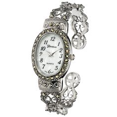 Add one of these lovely Geneva platinum watches to your personal wardrobe for an elegant accessory that completes your existing timepiece collection. The scrolled detailing and cuff bracelet will complement any outfit during an evening out.