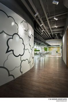 Working creativity into space; amazing wall graphics and open ceiling