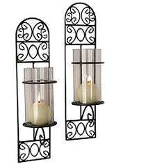 @Overstock - This set of two black iron wall sconces adds light and style to any room. With a distinctive scrollwork design and the included glass votive candleholders, you can enjoy a candlelit evening anytime you choose.http://www.overstock.com/Home-Garden/Madeira-Iron-Wall-Sconces-Set-of-2/4387501/product.html?CID=214117 $31.49