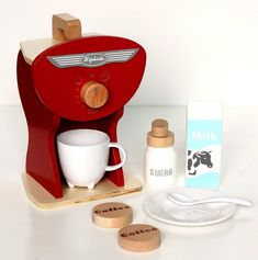 Wooden Toy Coffee Machine Set. Thats precious! Perfect for my friends who are gourmet coffee drinkers!!