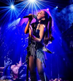 High notes: She sang her new track for the first time while at the iHeartRadio Theater, dressed in Halloween garb as Jack Skellington from the film, The Nightmare Before Christmas
