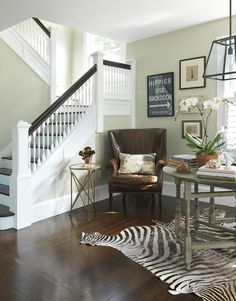 Love all the things going on in this corner.  Zebra rug pulls it all together and looks great with stairway banister, also.