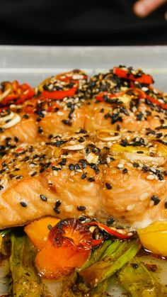 When you're craving fish with a kick, make this spicy baked salmon with a honey and soy sauce glaze, topped with sesame seeds.