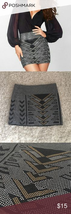 Fredricks of Hollywood studded mini skirt Never worn! This skirt is really cool! Aztec print gold and silver zipper in back Frederick's of Hollywood Skirts Mini