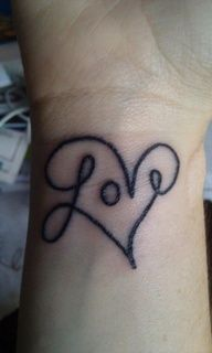 I love this wrist tattoo design! Love in cursive with the lines of the first and last letter forming a heart around the word.