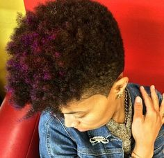 Tapered cut, shaved sides, natural hair, purple highlights
