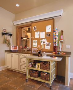 this room is off the kitchen.  the bulletin board rolls to close the opening...LOVE this!!