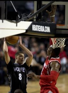 Minnesota Timberwolves' Zack LaVine (8), left, drives to the basket as Houston Rockets' Dwight Howard, (12), tries to block during the first half of an NBA basketball game in Mexico City, Wednesday, Nov. 12, 2014. (AP Photo/Dario Lopez-Mills)