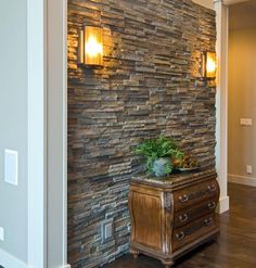 Love interior stone accent walls and columns. Gives Rustic classy look. Faux stone is so much more realistic now. Easy DIY panels to install check out a sample Faux Stone Walls, Stacked Stone Walls, Faux Brick Panels, Stone Accent Walls, Brick Paneling, Accent Walls In Living Room, Stone Panels, Accent Wall Bedroom, Stone Wall Living Room