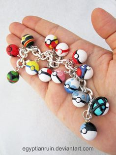 Pokeball Bracelet 2 by *egyptianruin 14 charms on a silvertone bracelet. Some parts are handpainted but most is polymer clay. Dusk Ball Cherish Ball Luxury Ball Fast Ball Timer Ball Premier Ball Regular Pokeball Master Ball Love Ball Dive Ball Net Ball Heavy Ball Moon Ball