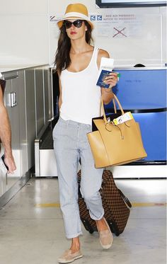 Alessandra Ambrosio shows that her Michael Kors Miranda Large Leather Tote is the perfect option for the girl on the go! // #celebritystyle