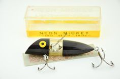 Neon Mickey Antique Fishing Lure - http://finandflame.com/neon-mickey-antique-fishing-lure/ - #Fishing, #Lure, #Neon, #NeonMickeyAntiqueFishingLure, #Oregon, #Salmon, #Tackle - Neon Mickey Antique Fishing Lure The Neon Mickey Antique Fishing Lure was first introduced in 1955. This novelty type lure was born by the Neon Mickey Company out of Oregon. This plastic fishing lure measures 4″ in length and was available in a few primary colors. The purpose or guise of...