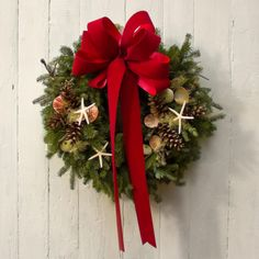 Seashell Balsam Wreath – Red  Our Seashell Balsam Wreath is double-sided, embellished with a red velvet bow, multiple pinecones, assorted seashells and starfish. Each wreath measures 22 to 24 inches in diameter and weighs a generous 4 pounds. https://www.themeadowofmaine.com/shop/seashell-balsam-wreath-red/  Each wreath will vary slightly as they are made by hand, one at a time.     Please note: This item cannot be gift wrapped.