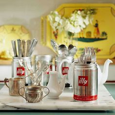 For your next party buffet, corral silverware into fun containers. Sorted and stored in tin coffee cans, flatware is easy to grab as guests make their way through the buffet line.