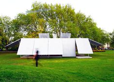 Sean Godsell's MPavilion Blooms Like a Flower With Steel-Clad Pneumatic Arms