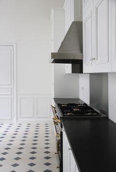 black & white tiled floor in the kitchen