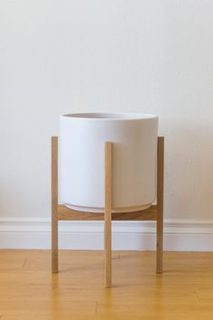 This modern planter stand is a remix of our best selling mid century style stand made of solid american white oak (without exposed dowels). This version also features a stockier width than our walnut and brass stands. Solid white oak finished with a oil/wax polish. This size is perfect for a medium to large room or apartment. Includes matte or gloss ceramic. Many additional glazes available for special request. - Stand: 13 internal diameter, 18 height, 14-1/2 width - Ceramic: 12...