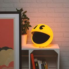 Pac- Man Lamp – Bathe your man cave in the warm glow of the 80s arcade classic Pacman.   This Pacman Lamp comes complete with the iconic video games sound effects.  You can adjust the brightness or trigger a sound with the included remote. Comes with 12 sound effects from the game that sound super crisp.
