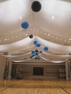I wouldn't mind having our reunion on our old gym if it looked like this! Drape with colored lanterns