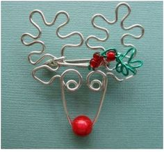 http://www.beadinggem.com/2011/09/whimsical-animal-wire-work-jewelry-by.html