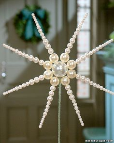 Pearl Tree Topper - No matter how tall or short your Christmas tree is, this regal topper will be just the right finishing touch -- and it will last for many Christmases to come.