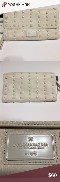 """BCBG Max Azria Studded Leather Clutch NWT BCBG Max Azria """"Eve"""" Studded Ivory Leather Clutch.  Fold over flap w/snap enclosure, round & pyramid stud detail throughout, removable wristlet strap, metal logo plate at lower front, & interior features a full size zipper pocket, cell phone & additional multipurpose pocket.  Dimensions are 11.5""""W x 6""""H x 1""""D.  Price is firm. BCBGMaxAzria Bags Clutches & Wristlets"""